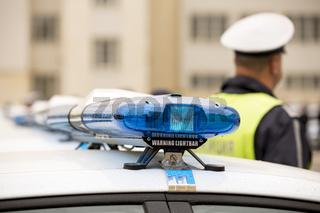 Police officers cars warning lightbars