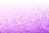 Abstract purple and white bokeh glitter background
