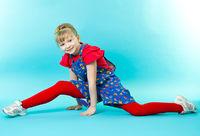 Little gymnast doing exercise