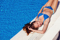 teen girl relaxing near swimming pool