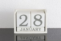 White block calendar present date 28 and month January