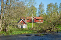 Old cottage at the river in the spring