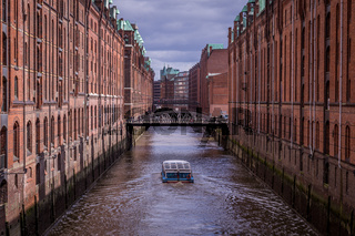 Famous Speicherstadt Warehouse District with Dark Clouds in Hamburg, Germany