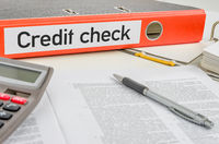 An orange folder with the label Credit check