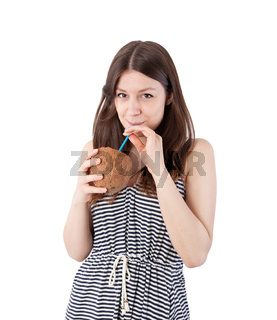 girl drinking from a coconut