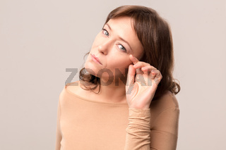 young beautiful woman in beige blouse