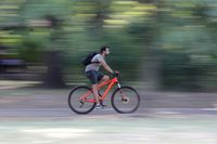Young man riding a bike in the park