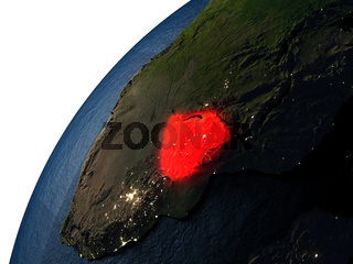 Zimbabwe in red on Earth at night