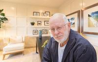 Senior Man Inside His Home Office.