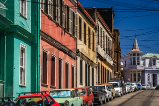 Row of cars parked on the hilly street in Valparaiso