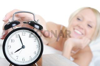Sleepy woman turns off the alarm