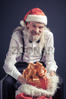 Office Santa with bag full of gifts.