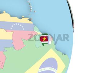 Suriname with flag on globe