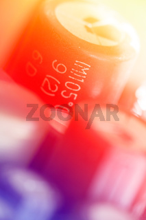 Colored electronic components (capasitors), shallow depth of field