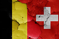 flags of Belgium and Switzerland painted on cracked wall