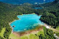 Lake Lago di Fusine Superiore Italy Alps. Aerial FPV drone flights.