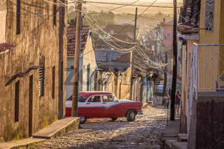 Cuban street with oldtimer in Trinidad