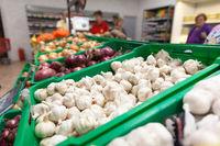 Garlic on supermarket vegetable shelf
