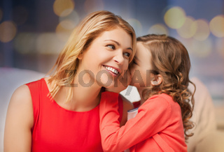 happy mother and girl whispering into ear