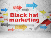 Advertising concept: arrow with Black Hat Marketing on grunge wall background