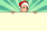 man with Santa hat sales banner
