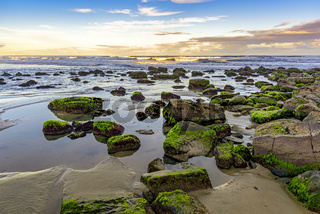 Stones and water with horizon line of Torres