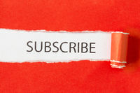 Subscribe Word on torn paper