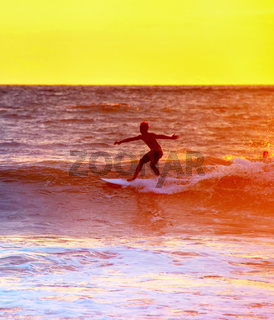 Bali surfing at sunset