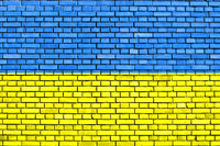flag of Ukraine painted on brick wall