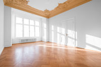 real estate interior - empty room in classical restored building  -