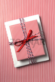 Christmas present wrapped with red striped paper