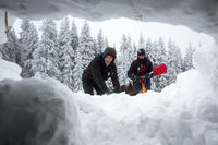 Red Cross rescuers through snow hole