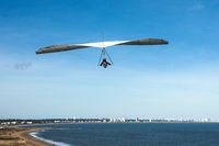 Hang-glider flies over the Punta Ballena cape, Punta del Este, Uruguay