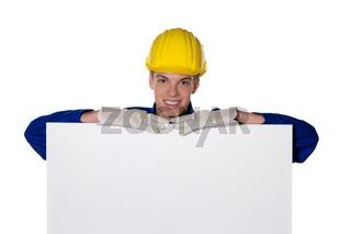 Lehrling / Azubi als Handwerker mit leerer Tafel