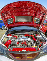 Wide open hood with colorful red parts under the hood