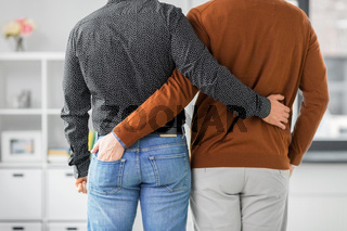 close up of hugging male gay couple