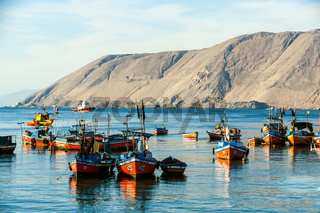 Iquique, Chile - March 17, 2011: Colourful wooden fishing boats in the harbour