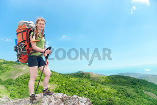 Hiking woman with backpack
