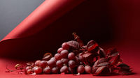 ripe fresh red grapes on a red background