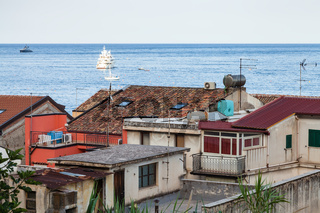 urban houses in Giardini Naxos and ships in Sea