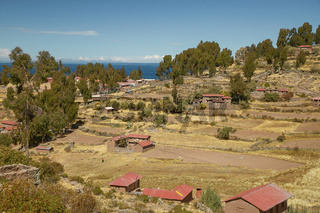 Houses of Local Peruvian Peope Living on Taquile Island (Isla Taquile) at Lake Titicaca  in Puno Peru