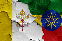 flag of Vatican and Ethiopia painted on cracked wall