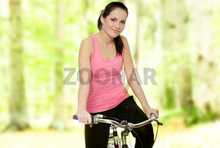 Attractive brunette woman with bike
