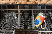 Cup and glass in dishwasher