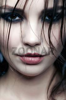 Close-up portrait of young brunette woman