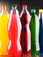 Plastic bottles of assorted carbonated soft drinks in variety of colors
