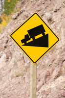 Yellow Square Road Sign Warning Steep Decline Ahead