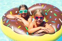 Two small girls having fun in pool