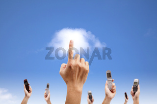 Hand touch the cloud and holding mobile phone. cloud computing and smart phone concept