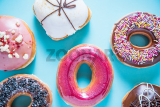 Vibrant artisan donuts on blue background